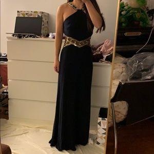 Black halterneck prom dress with gold emellishment